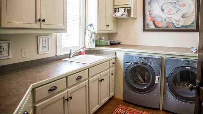 A Utility Sink Next To Washer