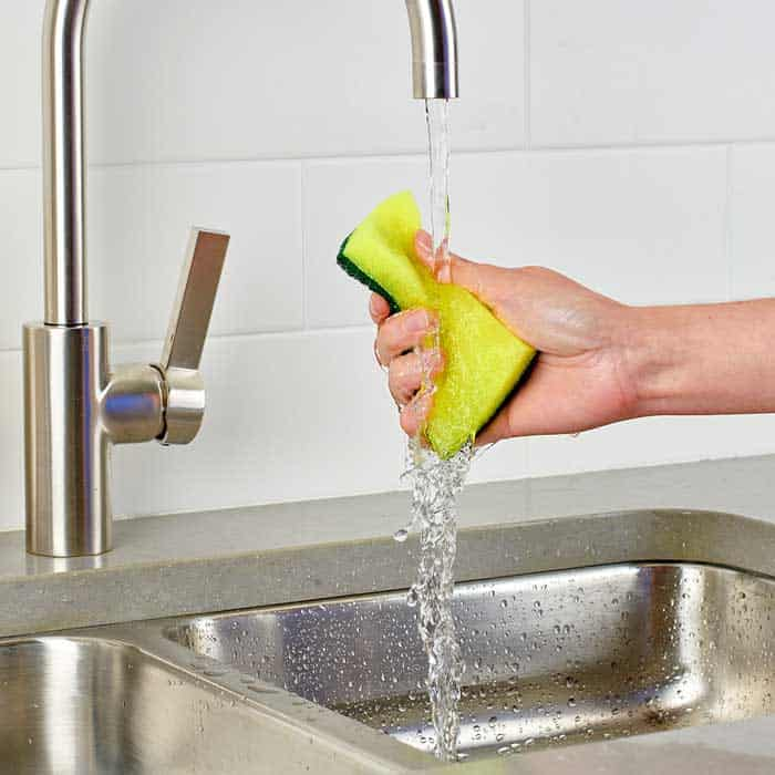 Scrub the sink with a scouring sponge